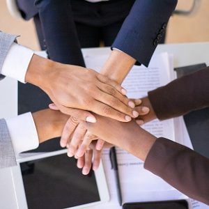 Business team showing unity with putting hands together. Businesspeople joining hands together. Stack of hands concept